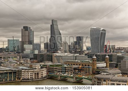 London UK - July 2016: Skyscrapers including the recent Walkie-Talkie building and the Gherkin rise above other towers and office buildings in the City of London