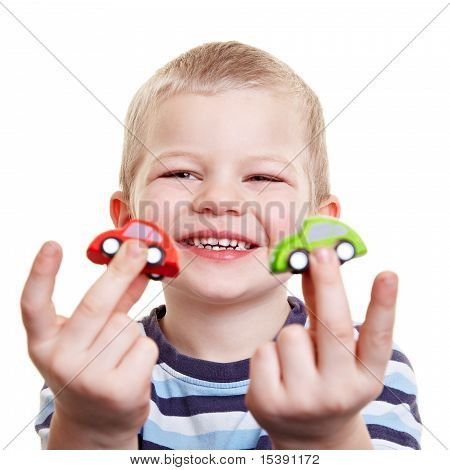 Happy Boy Showing Toy Cars