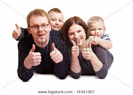 Happy Family Holding Thumbs Up