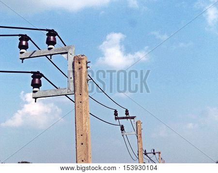 Electric pole connect to the high voltage electric wires on blue sky background