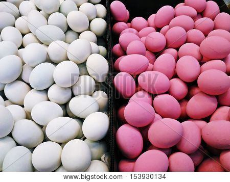 White eggs (Salted eggs) and Pink eggs (Preserved eggs or Century eggs) in the market