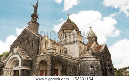 The Balata cathedral is a replica of Parisian Montmartre Sacre Coeur church lodged on a cliff surrounded by tropical forest Martinique island French West Indies.