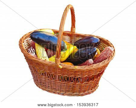 Yellow Corn And Eggplant Vegetable In Wicked Basket Isolated