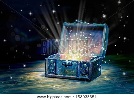 Close Up Concept Greeting Card Of Opened Vintage Chest Treasure With Mystical Miracle Light On Woode