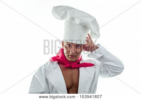 Young handsome cook on a white background in a large cap
