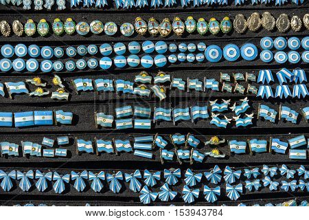 Buenos Aires Argentina - June 12 2016: A lot of Argentine pins on black board at the Feria de Mataderos Fair sunday fair in Buenos Aires Argentina.