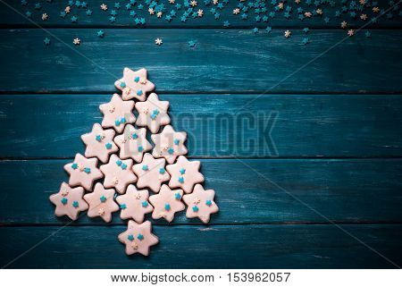Christmas tree made from cookies. Christmas baking concept. Christmas food background.