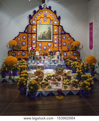 MEXICO CITY - OCTOBER 29, 2016: Traditional mexican day of the dead offering altar in Mexico City. Festivity celebrated throughout Mexico in October 31, November 1 and November 2