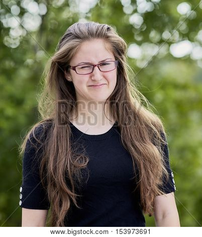 Young Adult Woman With Long Hair Showing Disgust
