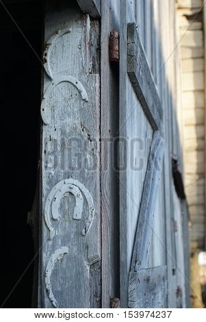 Old broken horseshoes hung on interior of barn door