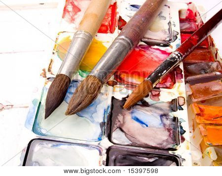 water-color, brush and palette isolated on white