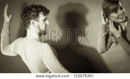 Aggressive Man Yelling On Woman.