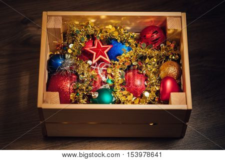 Christmas decorations stored in wooden box