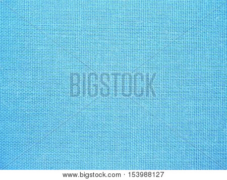 Close up blue fabric textured background for scrap booking