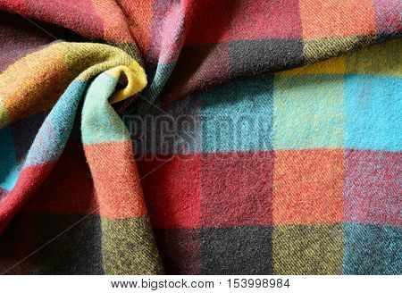 Closeup of colorful checkered plaid with drapery for background
