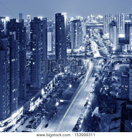 A bird's eye view of the city's modern architecture skyscrapers and busy road night views.