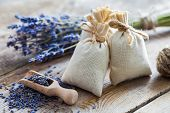Bunch Of Lavender Flowers And Sachets Filled With Dried Lavender. poster