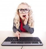 stock photo of outrageous  - Shocked office worker at a computer - JPG