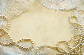 stock photo of doilies  - Vintage background with pearls and old doilies - JPG