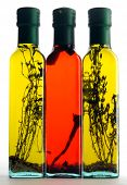 Three bottles of aromatic herbaceous and spicy oils poster