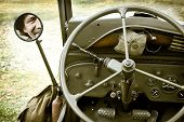 stock photo of willy  - Close up of vintage jeep Willys with man face in mirror - JPG