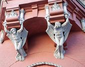 Architecture Demons On Wall Of House In Kiev poster