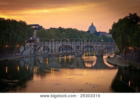 Panoramic view of St. Peter's Basilica and the Vatican City (with the river Tiber winding around it) at sunset - Rome, Italy