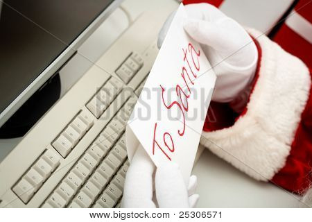 Close-up of Santa hands holding letter with note ?To Santa?