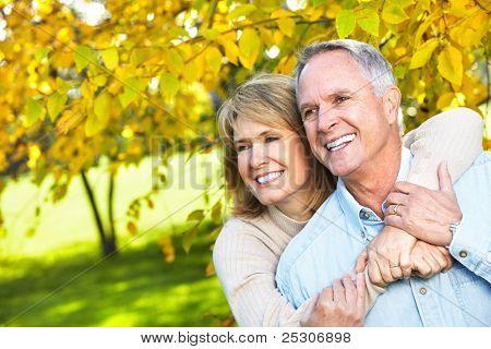 Happy senior couple in love in the park.