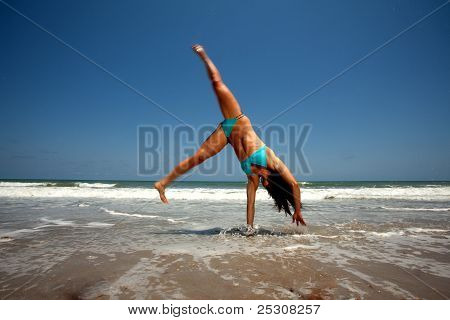 Young Brunette Woman In Blue Bikini At The Beach