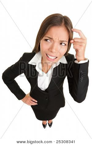 Thinking people. Business woman wondering funny looking to side pondering something while scratching head. High angle view of mixed race Caucasian /  Asian businesswoman isolated on white background.