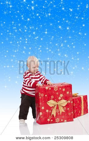 Christmas Baby Boy With Gift Box, He Has His Hands On The Big Gift Box