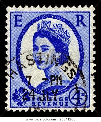 UK-CIRCA 1952:A stamp printed in United Kingdom shows image of Elizabeth II (Elizabeth Alexandra Mary) is the constitutional monarch of United Kingdom in blue, circa 1952.