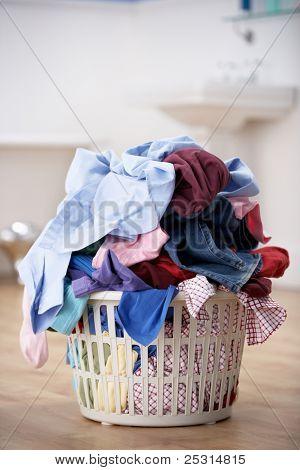 basket of dirty washing in bathroom