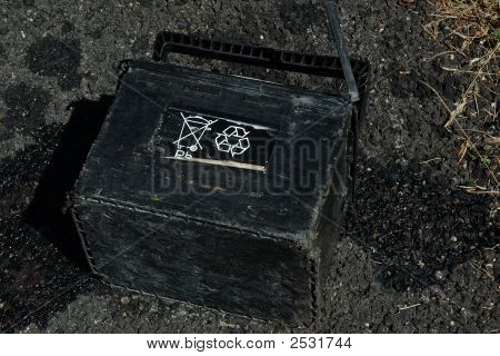 Leaking Car Battery Discarded On The Road
