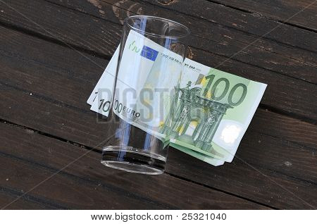 Empty Glass And One Hundred Euro Banknotes