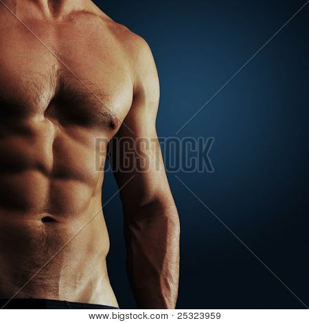 Part of a man's body on a dark blue background