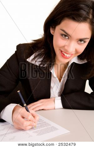 Young Businesswoman Signing A Document