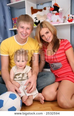 Father And Mother With Son In Playroom
