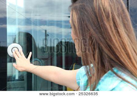 Women opening tram door