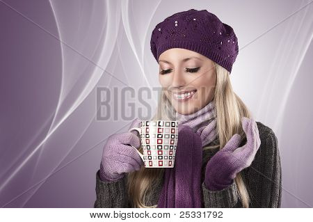 Winter Girl With A Hot Cup Of Tea