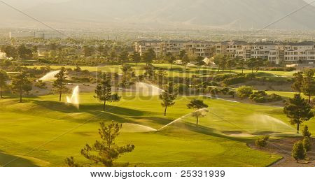 Irrigation Sprinklers In A Desert Golf Course