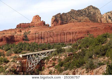 red rocks with bridge