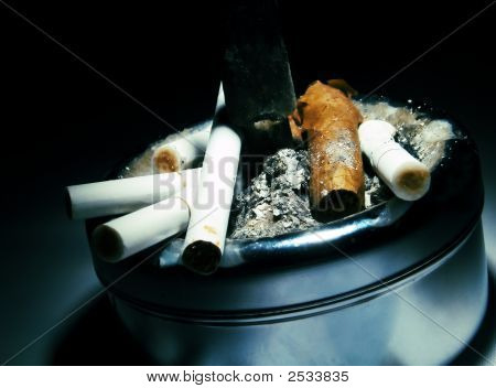 Ashtray With Cigarettes And A Cigar