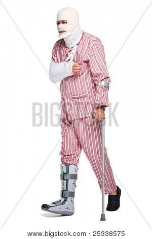 Photo of an injured man walking on crutches, isolated on a white background.
