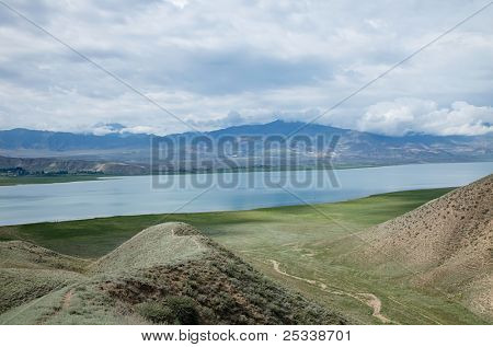 Toktogul  highland mountain lake in Kyrgyzstan, Jalal-Abad Province