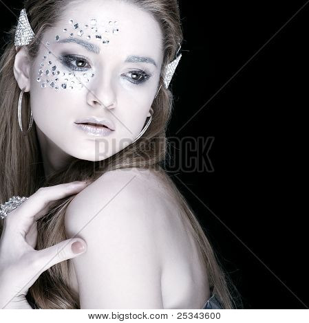 Portrait Of Sexual Beautiful Girl With Strasses On Face, On A Black Background