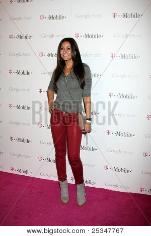 LOS ANGELES - NOV 16:  Emmanuelle Chriqui arrives at the Google Music Launch at Mr. Brainwash Studio on November 16, 2011 in Los Angeles, CA