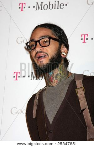 LOS ANGELES - NOV 16:  Travie McCoy arrives at the Google Music Launch at Mr. Brainwash Studio on November 16, 2011 in Los Angeles, CA