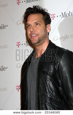LOS ANGELES - NOV 16:  Dane Cook arrives at the Google Music Launch at Mr. Brainwash Studio on November 16, 2011 in Los Angeles, CA